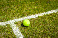 Tennis ball on a grass court stock photos