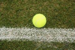 Tennis ball on grass tennis court Royalty Free Stock Photos