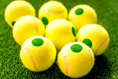 Tennis ball on green background close up stock photos