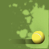 Tennis Ball on a Green Background Stock Photo