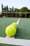 Tennis ball on green court. A photo of tennis ball on green court background royalty free stock photos
