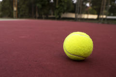 Tennis ball on green court. A photo of tennis ball on green court background royalty free stock photo