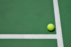 Tennis ball on green court Stock Photos