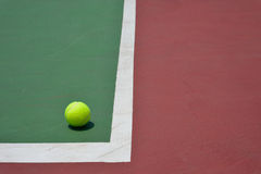Tennis ball on green court Royalty Free Stock Photo
