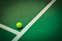 Tennis ball on green court Royalty Free Stock Photos