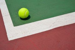 Tennis ball on green old court Royalty Free Stock Photography