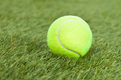 Tennis Ball On Green Pitch Royalty Free Stock Image