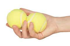 Tennis ball in hand Royalty Free Stock Images