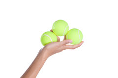Tennis ball in hand on white background Royalty Free Stock Images