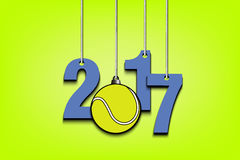 Tennis ball  and 2017 hanging on strings Stock Photo