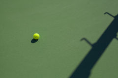 Tennis ball on hard court with copy space Stock Image