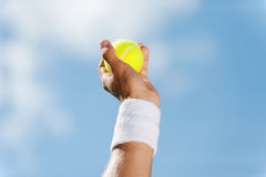 Tennis ball in his hand. Stock Images