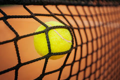 Tennis ball hitting the net royalty free stock images