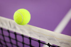 Tennis ball hitting the net Royalty Free Stock Photo