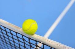 Tennis ball hitting the net Stock Photography