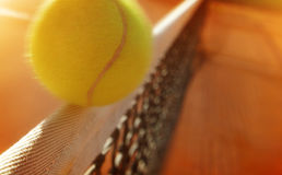 Tennis ball hitting the net Stock Images