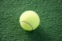 Tennis ball. On a indoor carpet court Royalty Free Stock Photos
