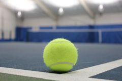 Tennis ball at indoor court Royalty Free Stock Images