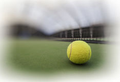 Tennis ball in indoor tennis court Royalty Free Stock Images