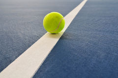 Tennis ball just on the line Stock Photo