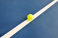 Tennis ball just on the line Stock Photography