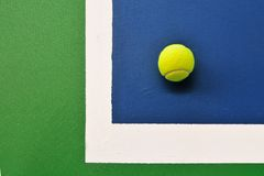 Tennis ball just on the line Stock Images