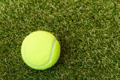 Tennis ball on the lawn Royalty Free Stock Image