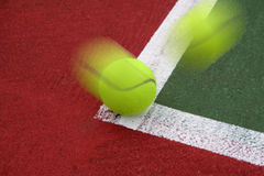 Tennis Ball on the Line. Tennis Ball hitting the Line stock photography