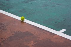Tennis ball on a line Royalty Free Stock Photo