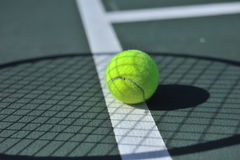 Tennis ball on the line Royalty Free Stock Photography