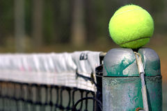 Tennis ball on the line. Tennis ball on top of the pole royalty free stock image