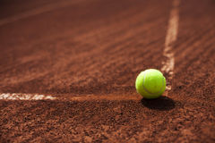 Tennis ball in the line Stock Photography