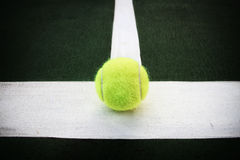 Tennis ball on line Royalty Free Stock Photography