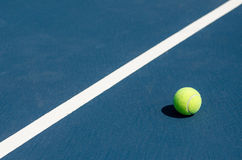 Tennis ball by line Royalty Free Stock Photography