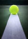 Tennis ball in line tennis court Stock Photo