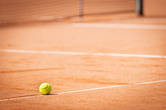 Tennis ball  lying on line in sand Royalty Free Stock Photo