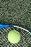 Tennis ball. Lying on racquet on tennis court stock photos