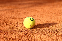 Tennis ball is lying on the tennis field close-up Royalty Free Stock Photography