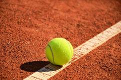 Tennis ball is on the markup diagonal horizontal Royalty Free Stock Images