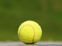 Tennis ball and meadow (45). Tennis ball and a green background Stock Photography
