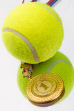 Tennis ball and medal Stock Photo