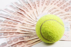 Tennis ball. On money prize Royalty Free Stock Images