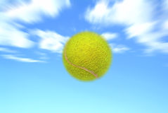 Tennis ball. Moving tennis ball against blue sky royalty free stock images