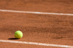 Tennis ball near the line Royalty Free Stock Photo