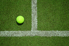 Tennis ball near the line on tennis grass court good for backgro Stock Photo