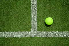 Tennis ball near the line on tennis grass court good for backgro Royalty Free Stock Photography