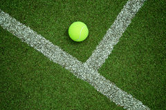 Tennis ball near the line on tennis grass court good for backgro Stock Photos