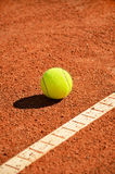 Tennis ball near markup diagonal vertical Royalty Free Stock Images