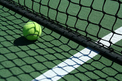Tennis ball near net Royalty Free Stock Images