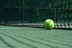 Tennis ball near net Stock Photography